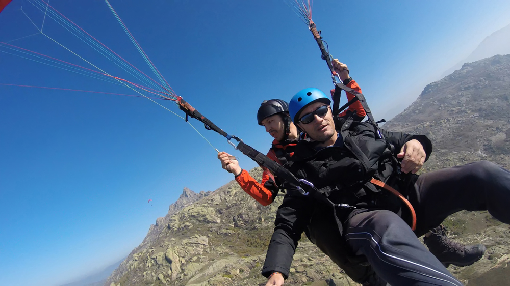 Man and women paragliding