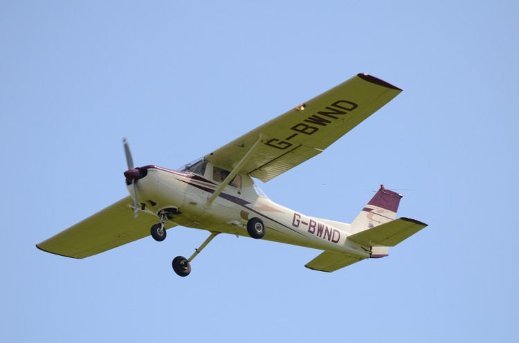 Two-seat plane in flight
