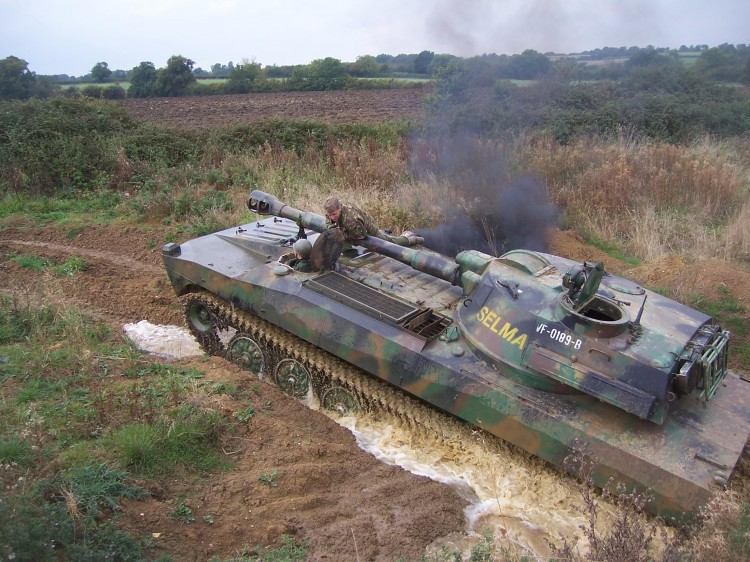 Tank driving through the mud