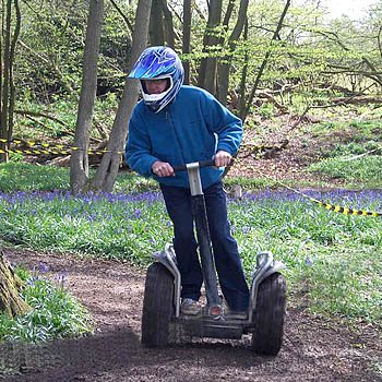 man in woods on a segway