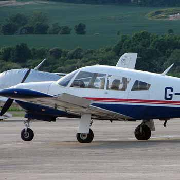 blue and white Cessna 152