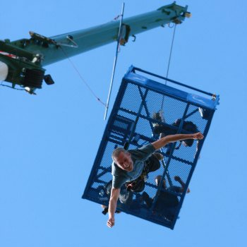 Man smiling whilst doing a bungee jump