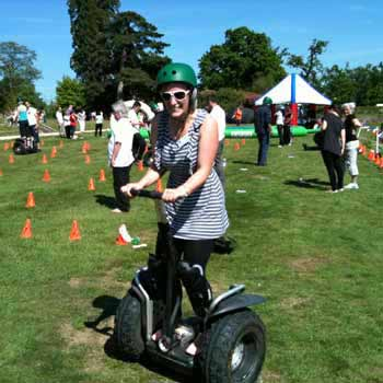 segway lady riding around cones
