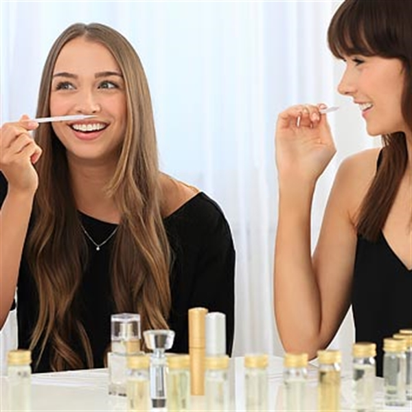 girls smelling perfumes